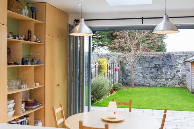 In the end terrace the kitchen/dining room opens out to the garden via bifold doors. Photo: Matteo Tuniz