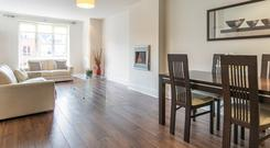 The open-plan living, dining room and kitchen is 360 sq ft.