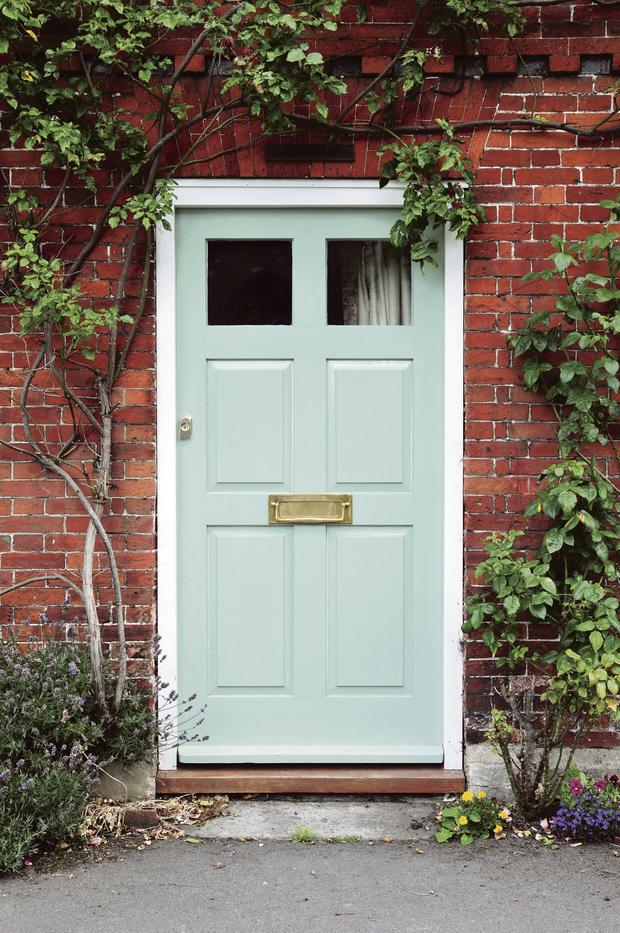 Front door painted in Clotted Cream, from a collection by Fleetwood.