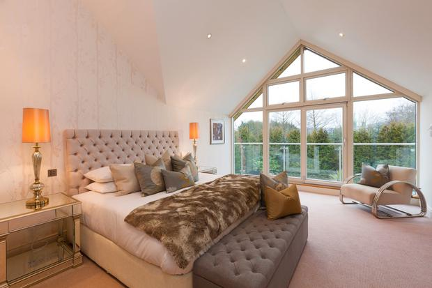 The master bedroom has a balcony with views of the Dublin Mountains
