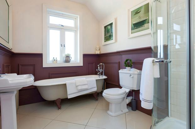 The main bathroom with a free-standing bath