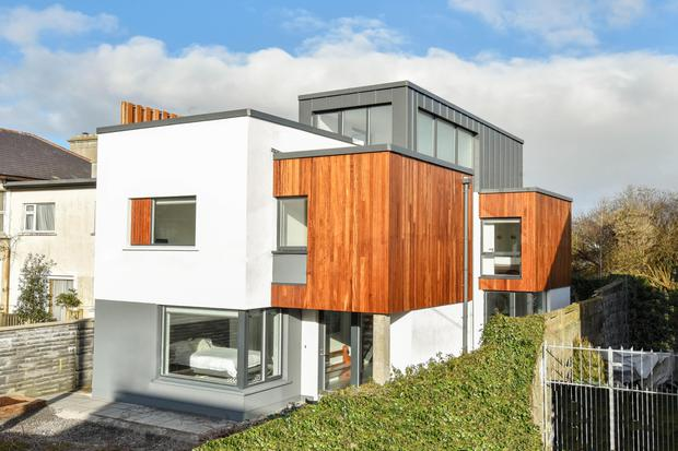 This architecturally interesting three-storey build, clad in iroko and zinc, is in turnkey condition.