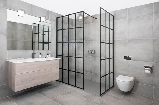 Black industrial-style shower frame from Tile Style