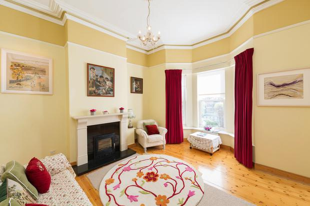 The drawing room has a bay window and a solid-fuel stove