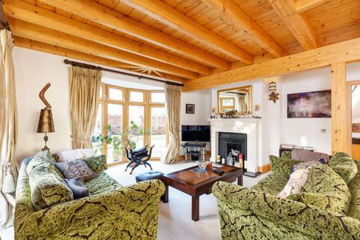 Living room with exposed timber beams and ceiling