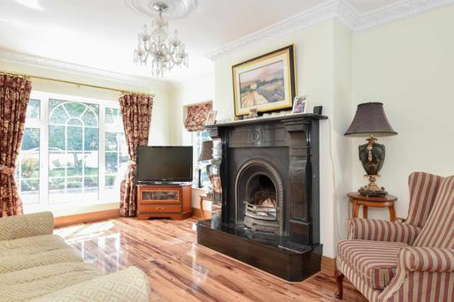 The living room with a marble fireplace