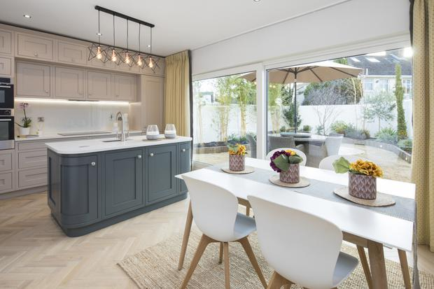 The open-plan dining/kitchen area has sliding doors to the garden, which is landscaped and south-west facing