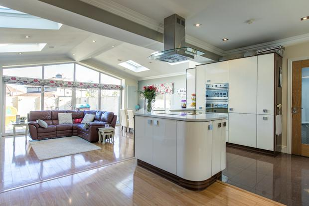 The open-plan kitchen and family room at the back