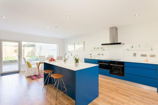 The open-plan kitchen and dining room in the extension