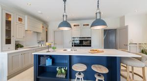 The kitchen/dining space at Neptune House is contemporary in style with hand-painted units