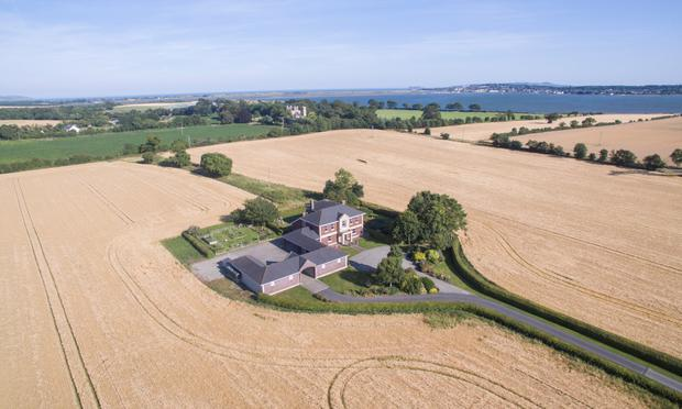 An aerial shot with estuary in the background