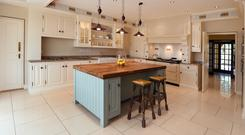 The 17ft square kitchen has a double Belfast sink and an Aga