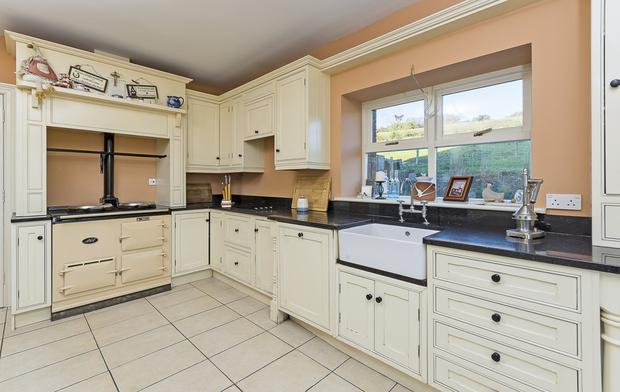 The kitchen has a Belfast sink and an Aga