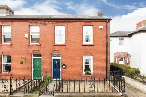 28 Ellesmere Avenue is a two-storey red-brick terrace
