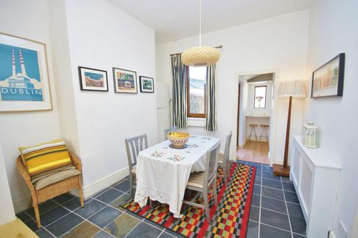 The dining room is at the back and leads to the kitchen
