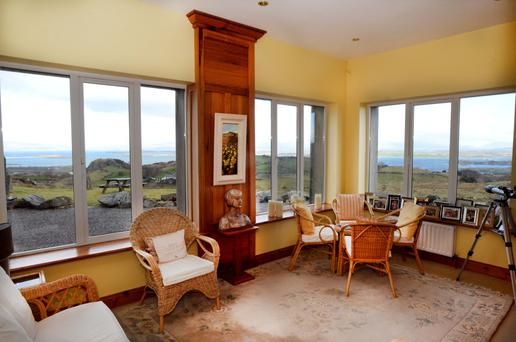 The sunroom has views over the mountains and the sea