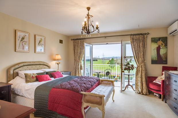 The master bedroom has a balcony which looks out over the 18-hole Heritage golf course at the back of the house