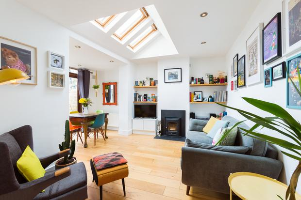 The open-plan living and dining room with skylights