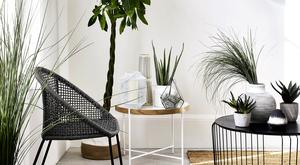 Paired with white walls, greenery and dashes of metallics, black looks fresh for spring and summer. Wire cage coffee table, €216, Debenhams