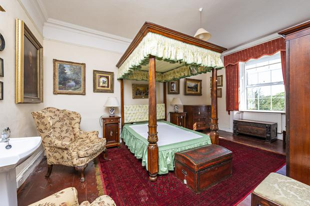 A bedroom with four-poster bed