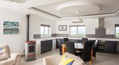 The triple-aspect kitchen and family room is on the first floor, making the most of the views out to sea