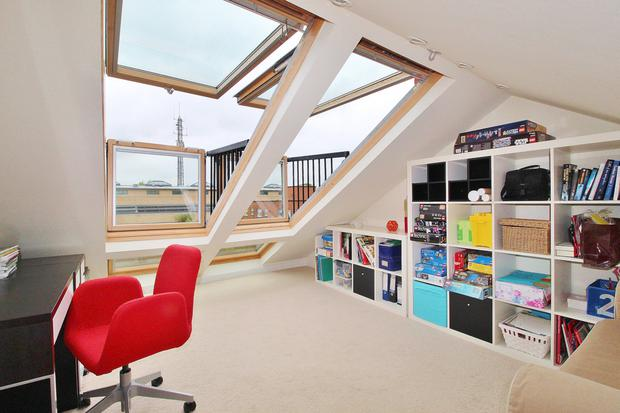 The converted attic is used as an office and has three push-out balcony Velux windows