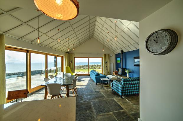 ENERGY BOOSTERS: Well-orientated energy-efficient windows, rooflights and doors reduce heat loss and optimise views. While stone floors have a high embodied energy.