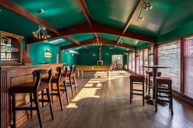 The games room has a fully equipped bar and snooker table
