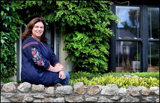 Helen Carter outside her wisteria-clad home in Dalkey