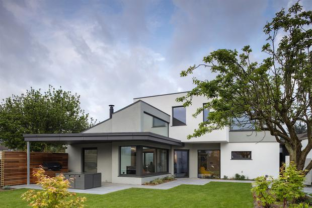 The extension twists away from the original house, adding space, shade, shelter and sun light