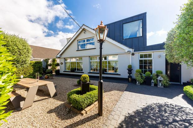 The traditional 1960s dormer bungalow frontage gives little away about what's around the side