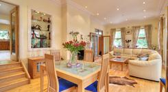 The open-plan living and dining room measures 32ft by 14ft