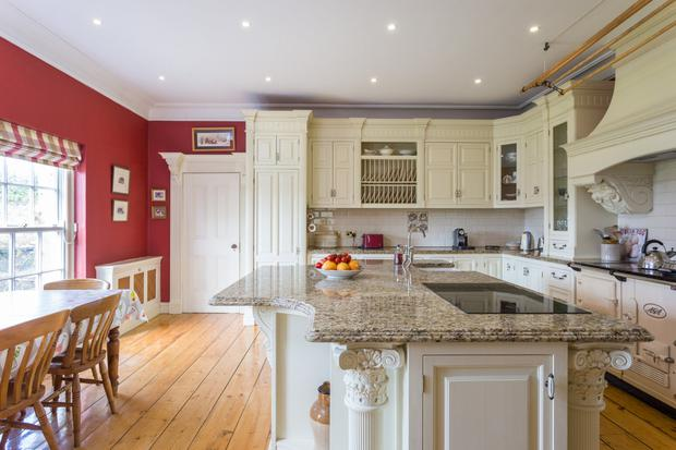 The hand-painted kitchen has marble worktops
