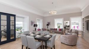 A living and dining area in one of the apartments in Neptune House