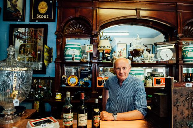 Victor Mee with the whiskey collection ahead of the auction