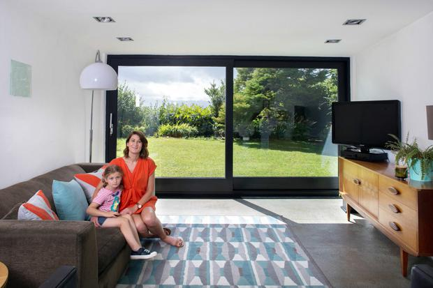 Linda Shevlin and daughter Ruby in the living room which has floor-to-ceiling sliding glazed doors