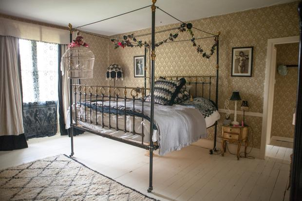 Daisy's bedroom is a winsome mix of lace curtains from Pearl's range and a delicate metal four poster