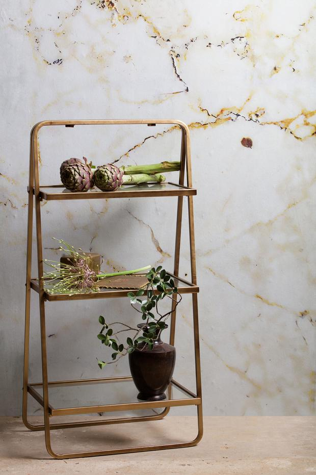 Cuckooland's brass and glass shelving unit is a tidy addition to a living room or kitchen, with just enough nod to the trend. €168, cuckooland.com