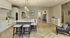 Wine and dine: Each house has a solid wood in-frame bespoke kitchen from Nolan Kitchens with an island unit and wine fridge