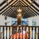 The gallery landing overlooks the three storey high grand dining hall at Tudor Lodge in Glenbrien near Enniscorthy, Co Wexford