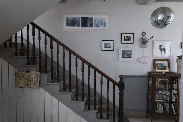 The pared-back staircase and painted floorboards are typical of Roisin's utilitarian approach.