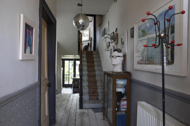A pared-back staircase and painted floorboards are typical of Roisin's utilitarian approach.