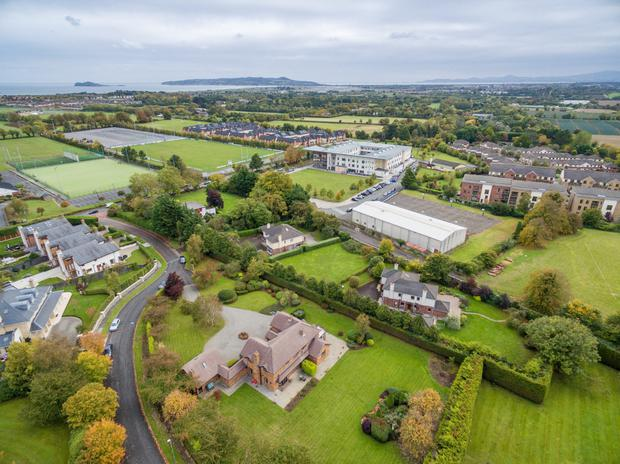 Aerial view of the property (at the bottom of the photo) which occupies just over an acre