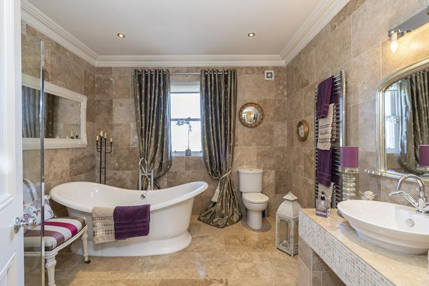 The main family bathroom has a tub specially sourced in England. The bathroom is also tiled full floor and full walls.