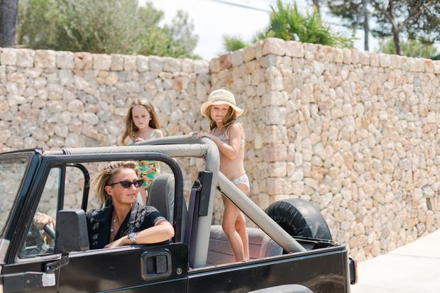 Zoe with her daughters Eden (six) and Dylan (five). Zoe and her husband felt that by adopting the sunny outdoor life in Majorca, they are delaying the inevitable intrusion of TV and technology into the girls' lives