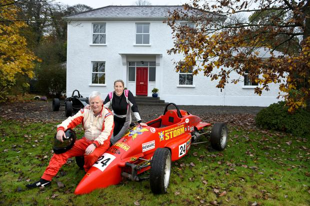 Ray and Paula Moore outside their home