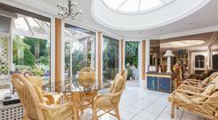 The sunroom has a large circular skylight