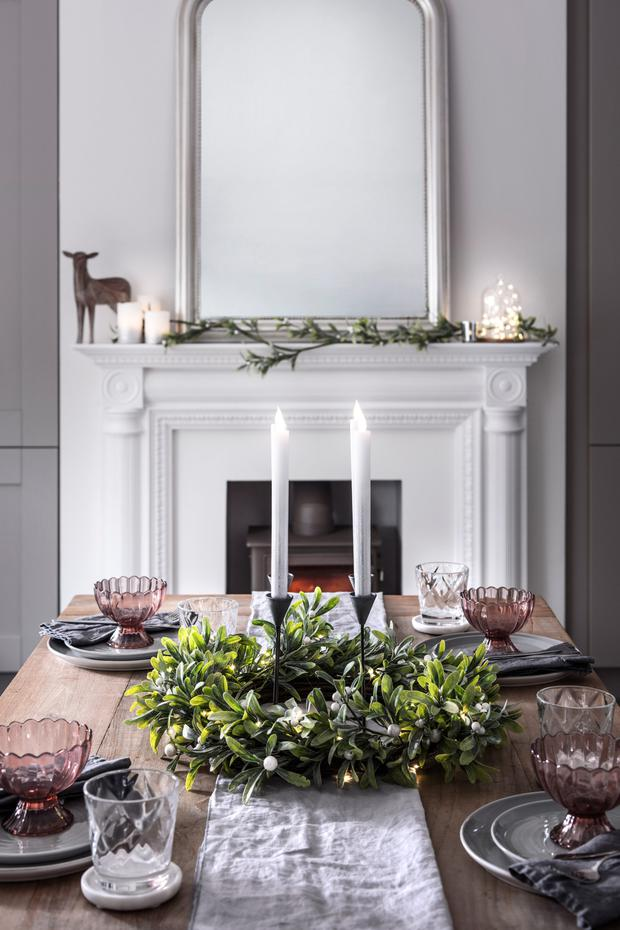 Candles, Christmas lights, foliage garland and a little snow – that's all a good table-scape needs; Lights4fun.co.uk