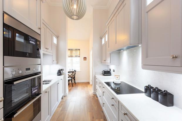 The kitchen has marble worktops and brand-new integrated appliances