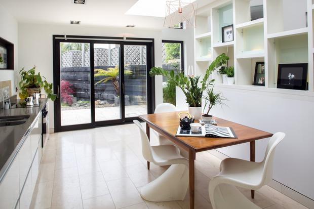 The kitchen/dining room has sliding doors to the garden